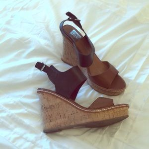 Tan and black dolce vita wedges